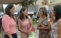 Almudena Gallego y Yolanda Talavera de la Fundación Anna O. con Milagros Maté del Centro de Información a la Mujer de Torremolinos